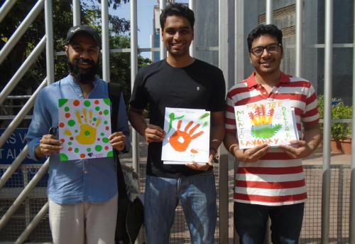 mentors-with-their-mentees-hand-prints-main